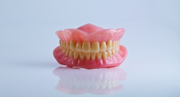How to Maintain Your Teeth's Health While Wearing Dentures?
